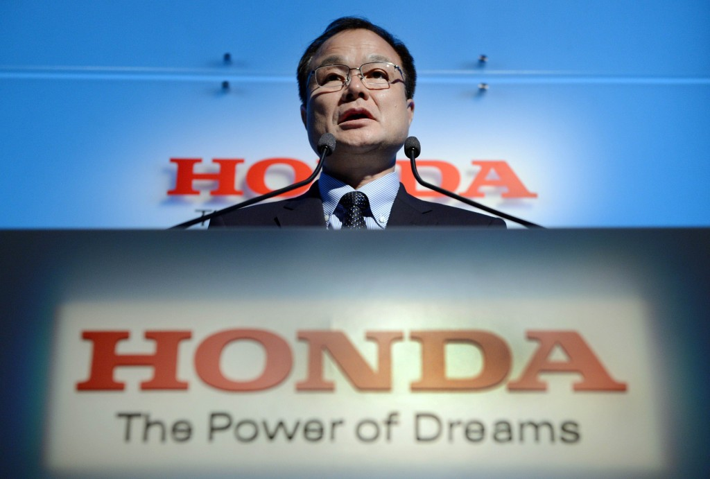 Takanobu Ito, president and CEO of Japan's auto maker Honda Motor makes a speech during a press conference at the headquarters in Tokyo on September 21, 2012. Ito said that Honda aims to sell more than 6 million cars and over 25 million motorcycles worldwide in the fiscal year. AFP PHOTO/Toru YAMANAKA